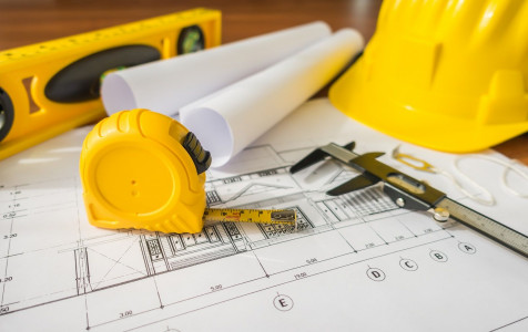 construction-plans-with-yellow-helmet-drawing-tools-bluep (2).jpg