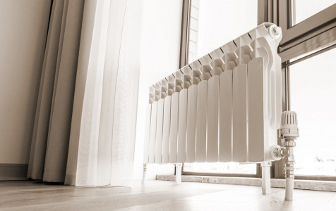 white-big-radiator-near-window-modern-room-sepia-toning.jpg