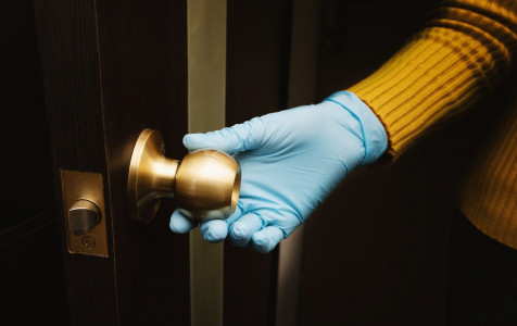 female-hand-protective-glove-open-door.jpg